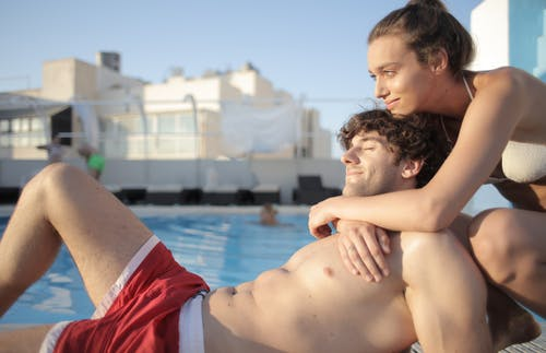 Couple in love enjoying time near swimming pool