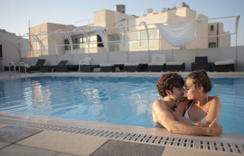 Couple in love embracing in swimming pool