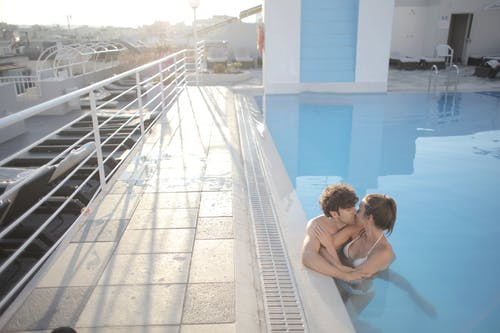 Man and Woman Kissing in the Swimming Pool