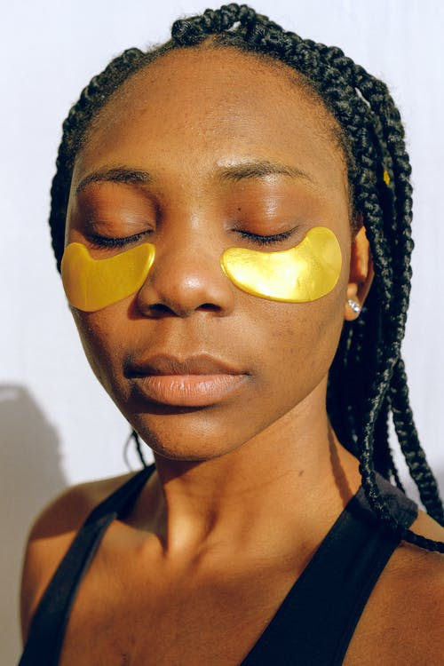 Woman With Yellow Face Mask