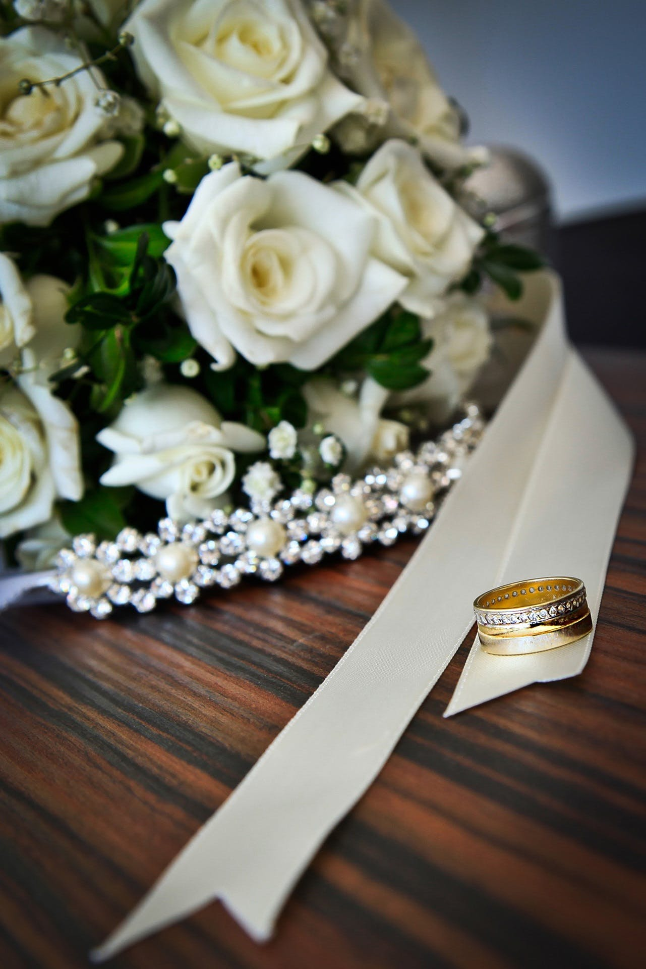 White Roses Bouquet Beside Gold-colored Ring