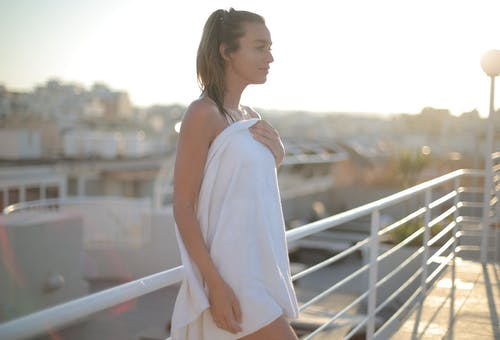 Woman Covering Her Body With A Towel