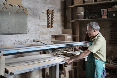 Gray haired artisan working in workshop