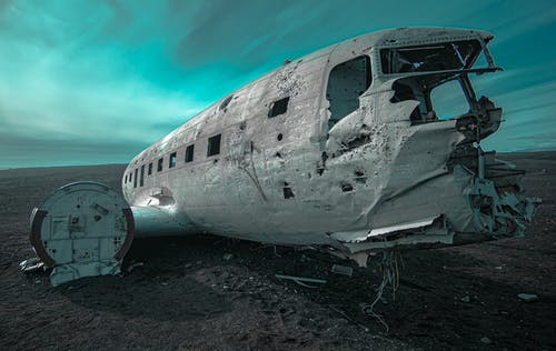 Wrecked White Airplane on Gray Sand