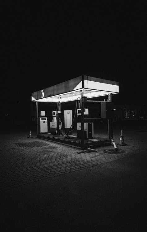 Grayscale Photo of a Gas Station