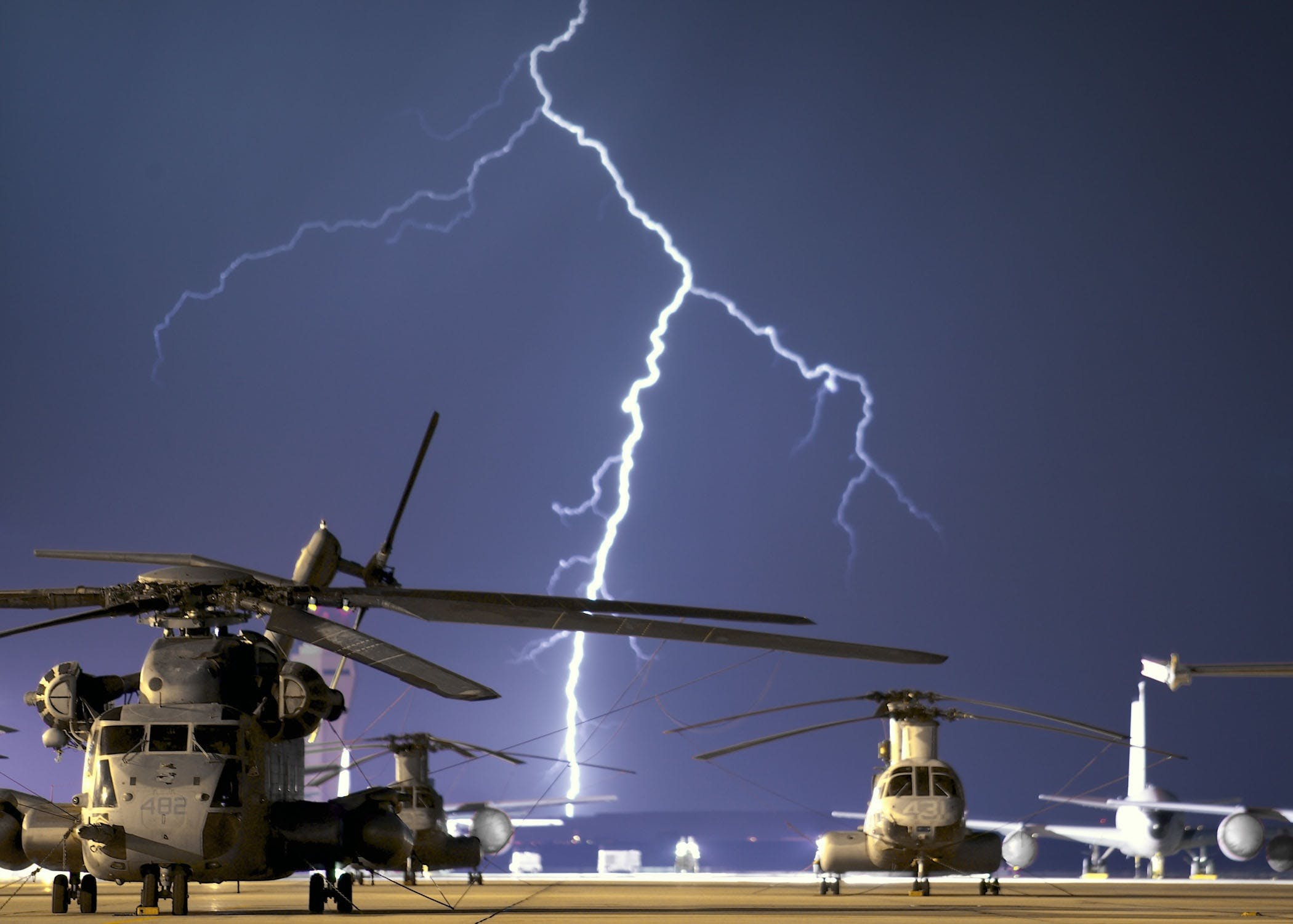 Lightning Near Grey Helicopter during Daytime