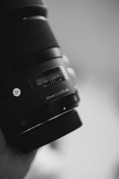 Black Camera Lens on White Table