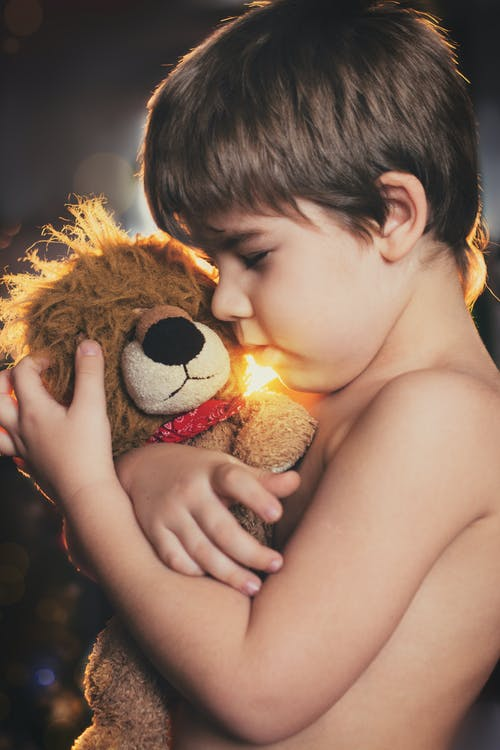 Boy Holding Brown Bear Plush Toy