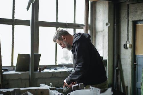 Adult male mechanic working in garage