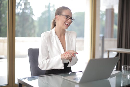 Smiling businesswoman with laptop in office