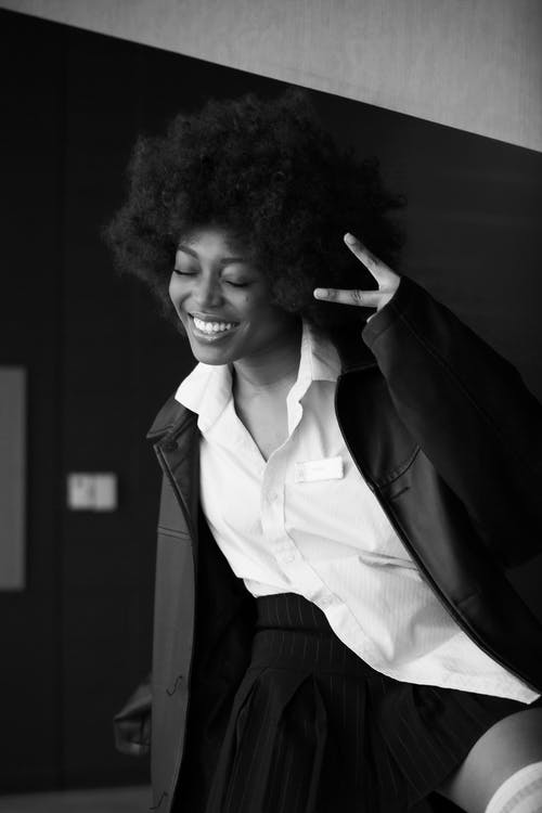 Woman in Black Blazer Smiling