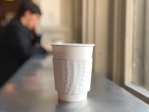 White Disposable Cup on Table