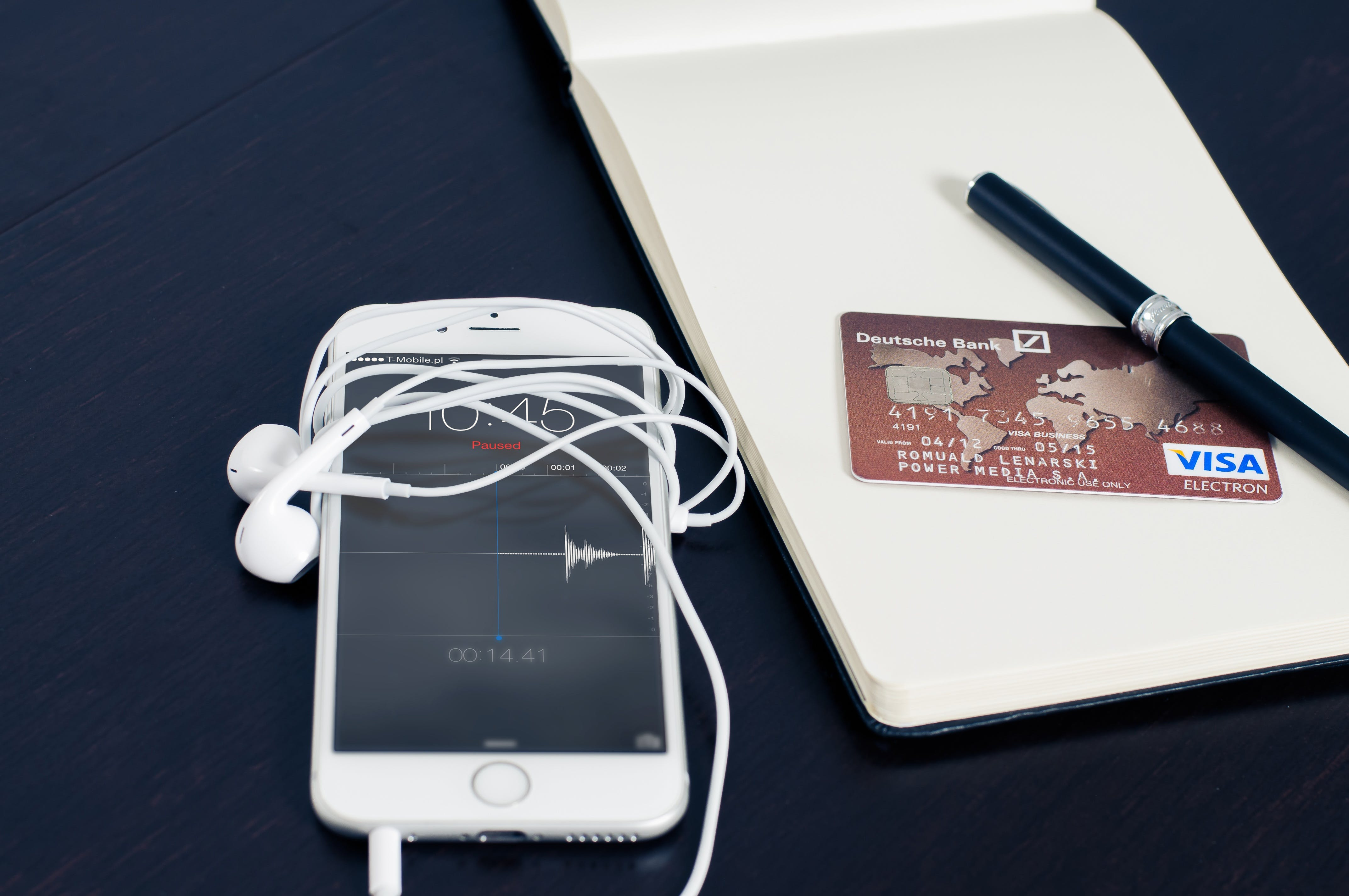 Silver Iphone 6 Beside Red Visa Card