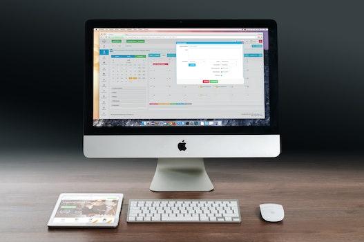 Kostenloses Stock Foto zu apfel, schreibtisch, büro, technologie