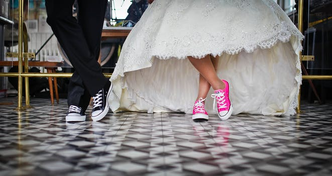 Woman Wearing Pink and White Low Top Shoes Dancing Beside Man