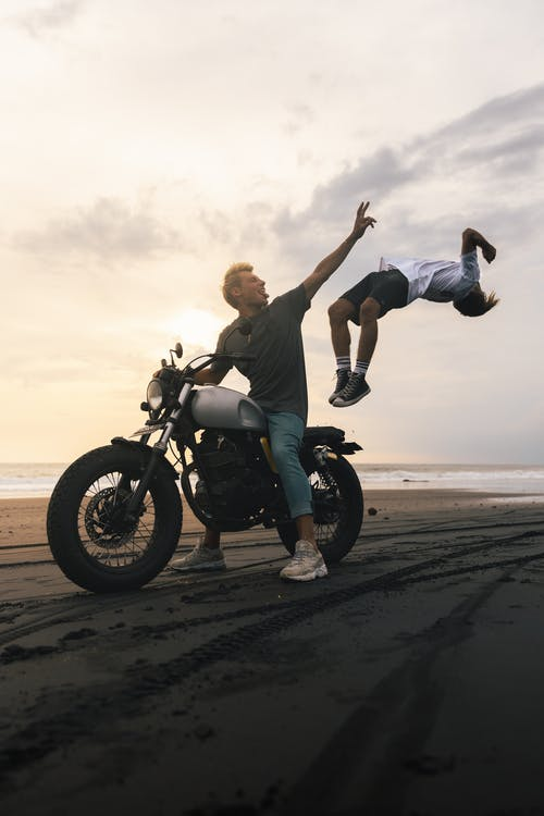 Man Riding Motorcycle On Gray Sand