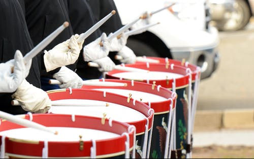 Group of People Playing Drums during Daytime