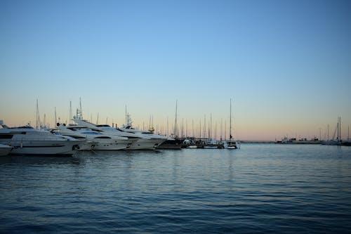 Free stock photo of Beautiful sunset, boats, docks