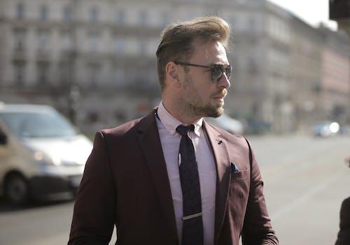 Man in Brown Suit Wearing Eyeglasses