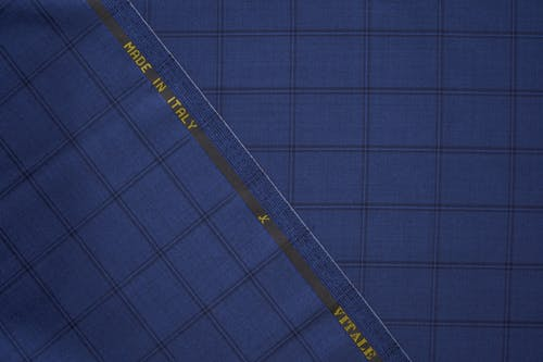 Top view of blue elegant suit fabric with geometric patterns and made in Italy inscription
