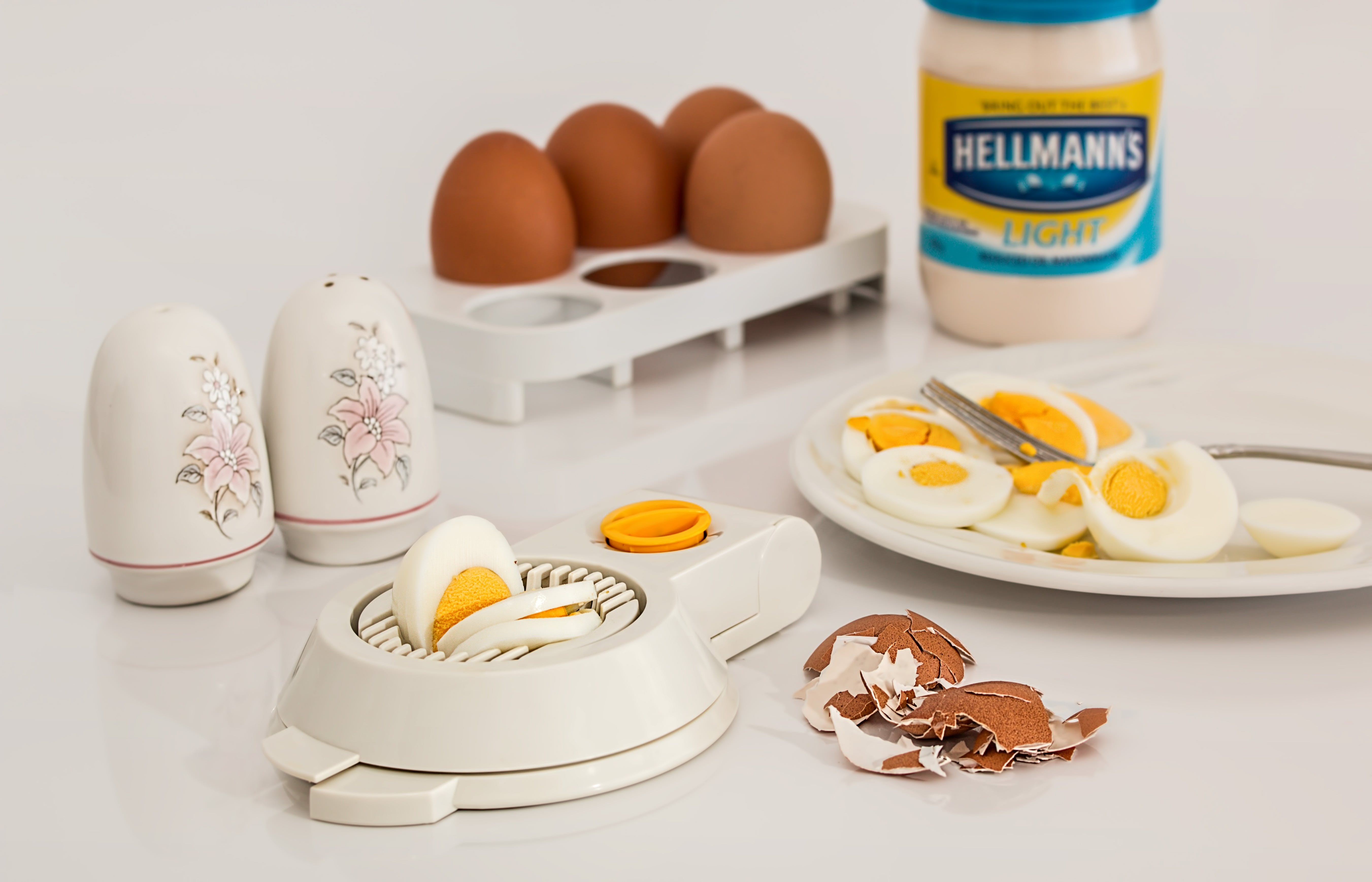 Hellmanks Glass Jar Beside White Egg Rack