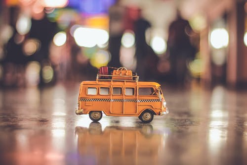 Selective Focus Photography of Yellow School Bus Scale Model