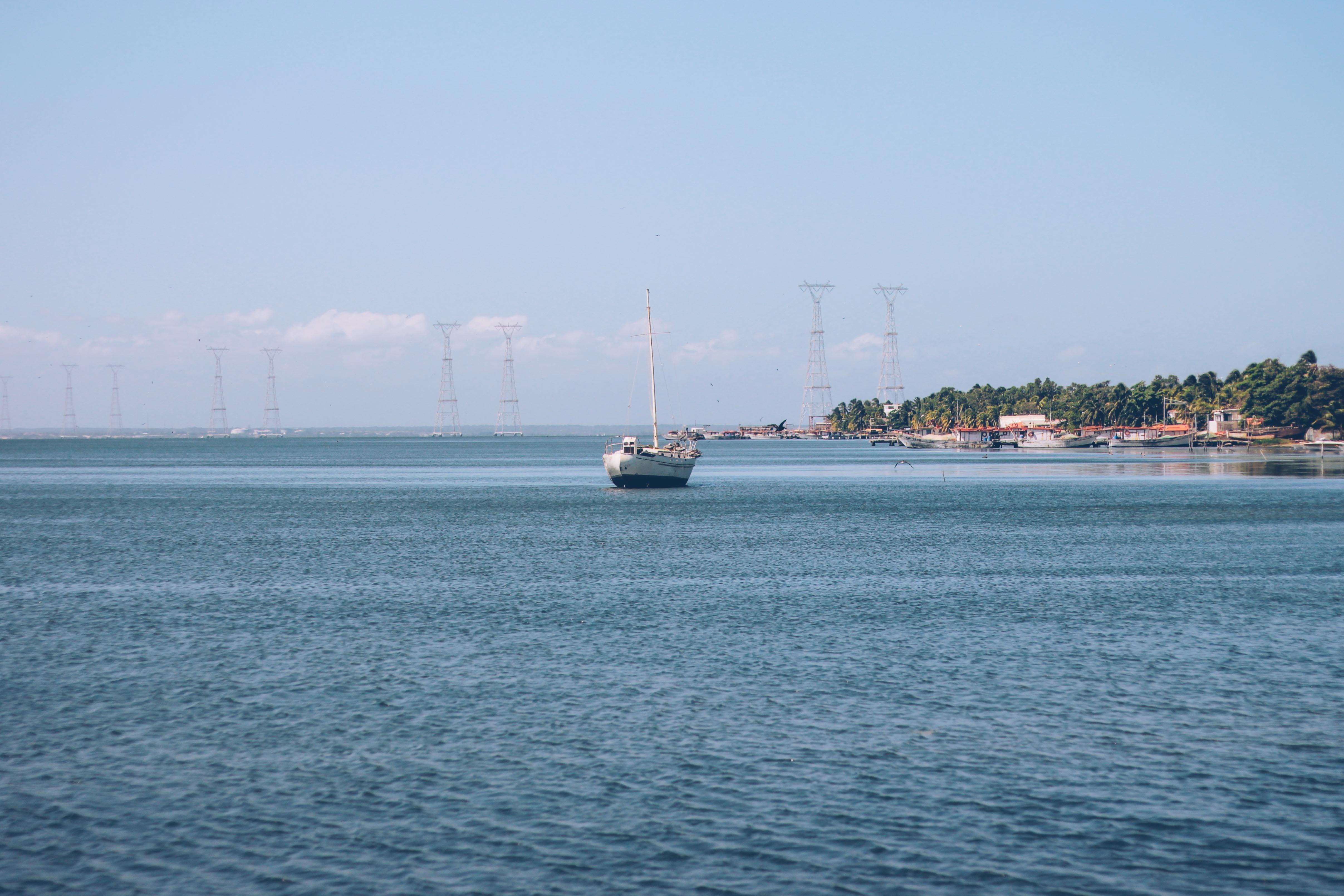 Free stock photo of blue, boat, coast, sail