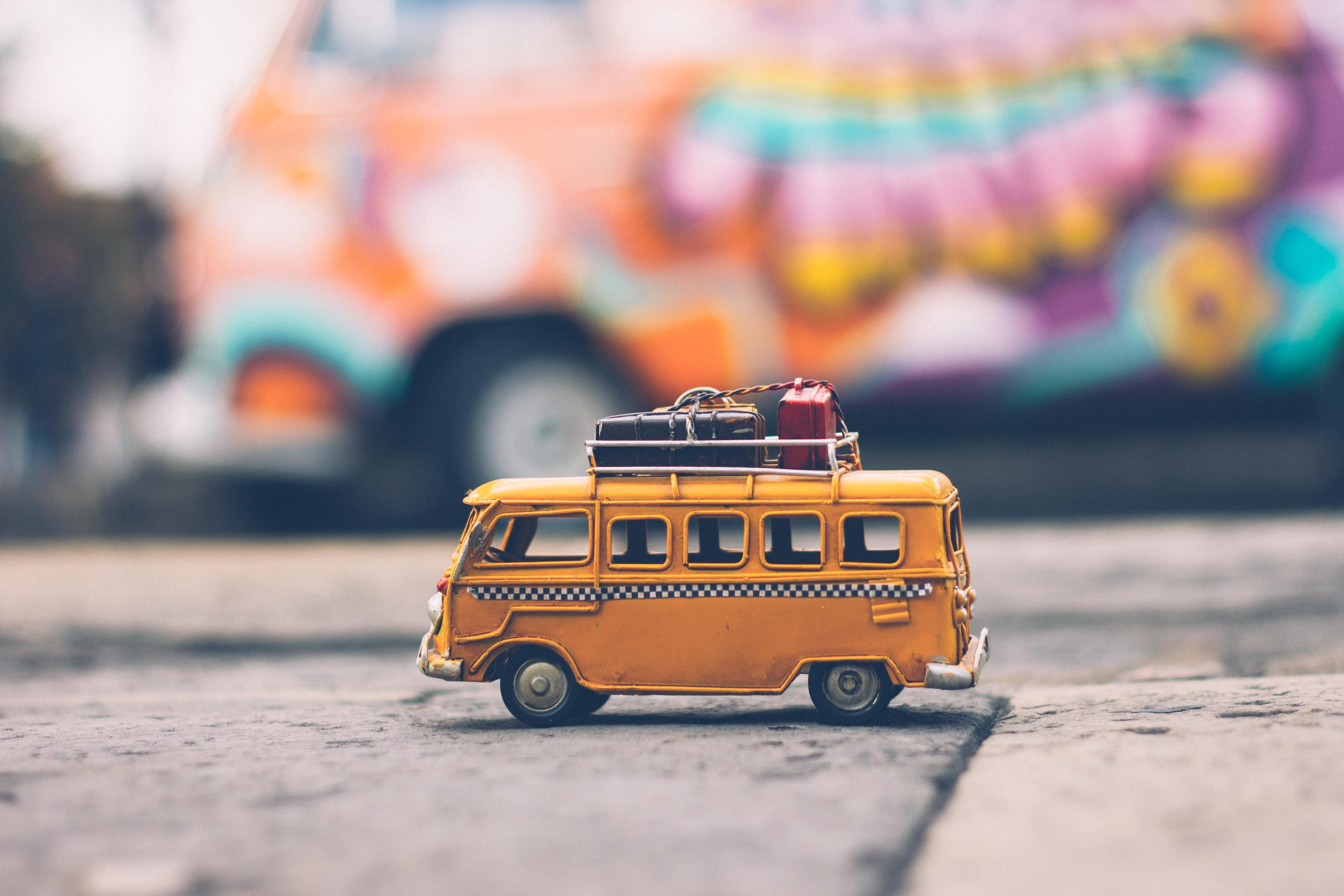 Selective Focus Photography of Yellow School Bus Die-cast