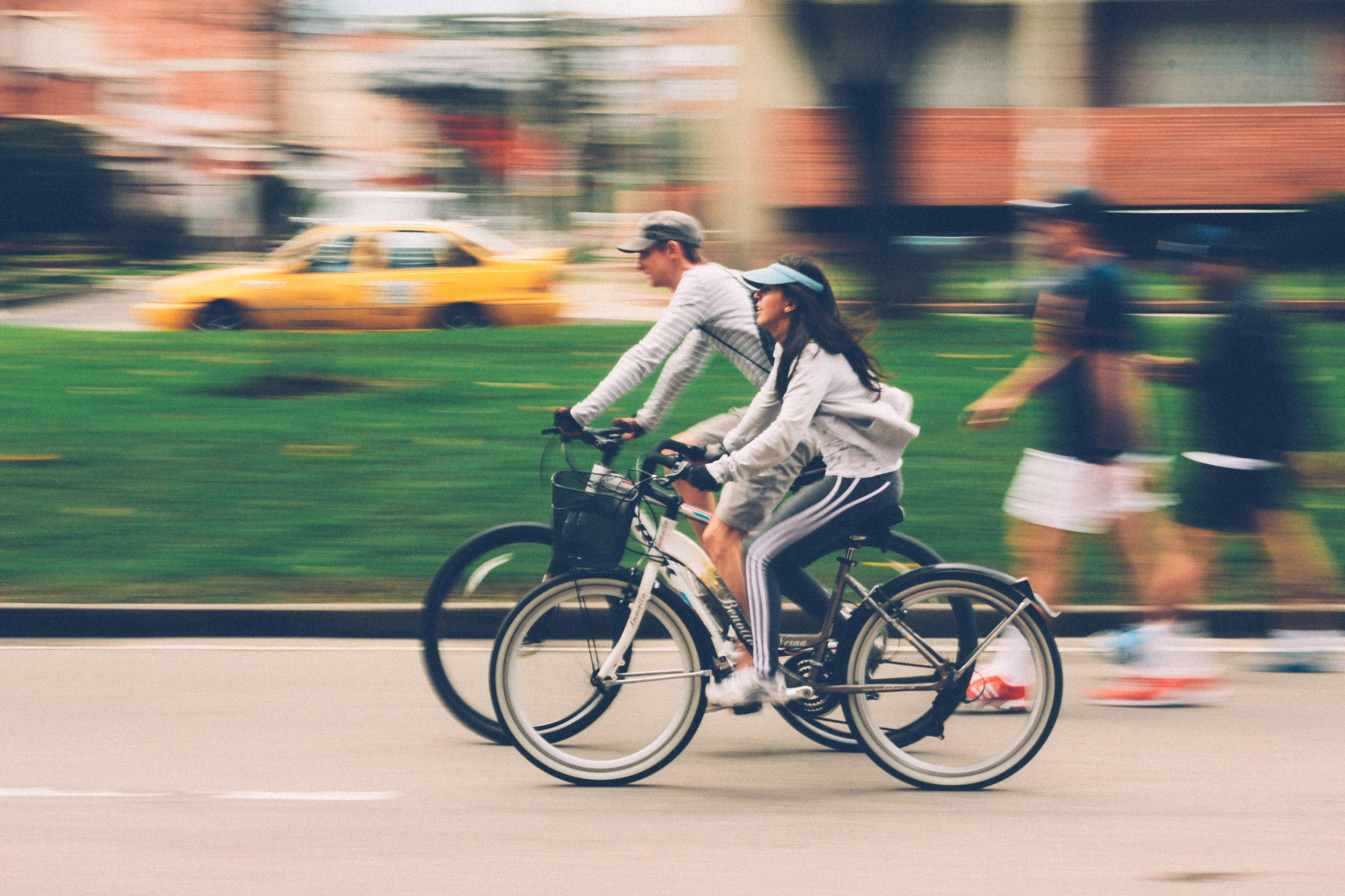 Woman and Man Riding on Bike