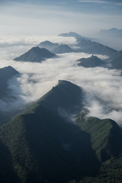 Green Mountains On White Low Clouds