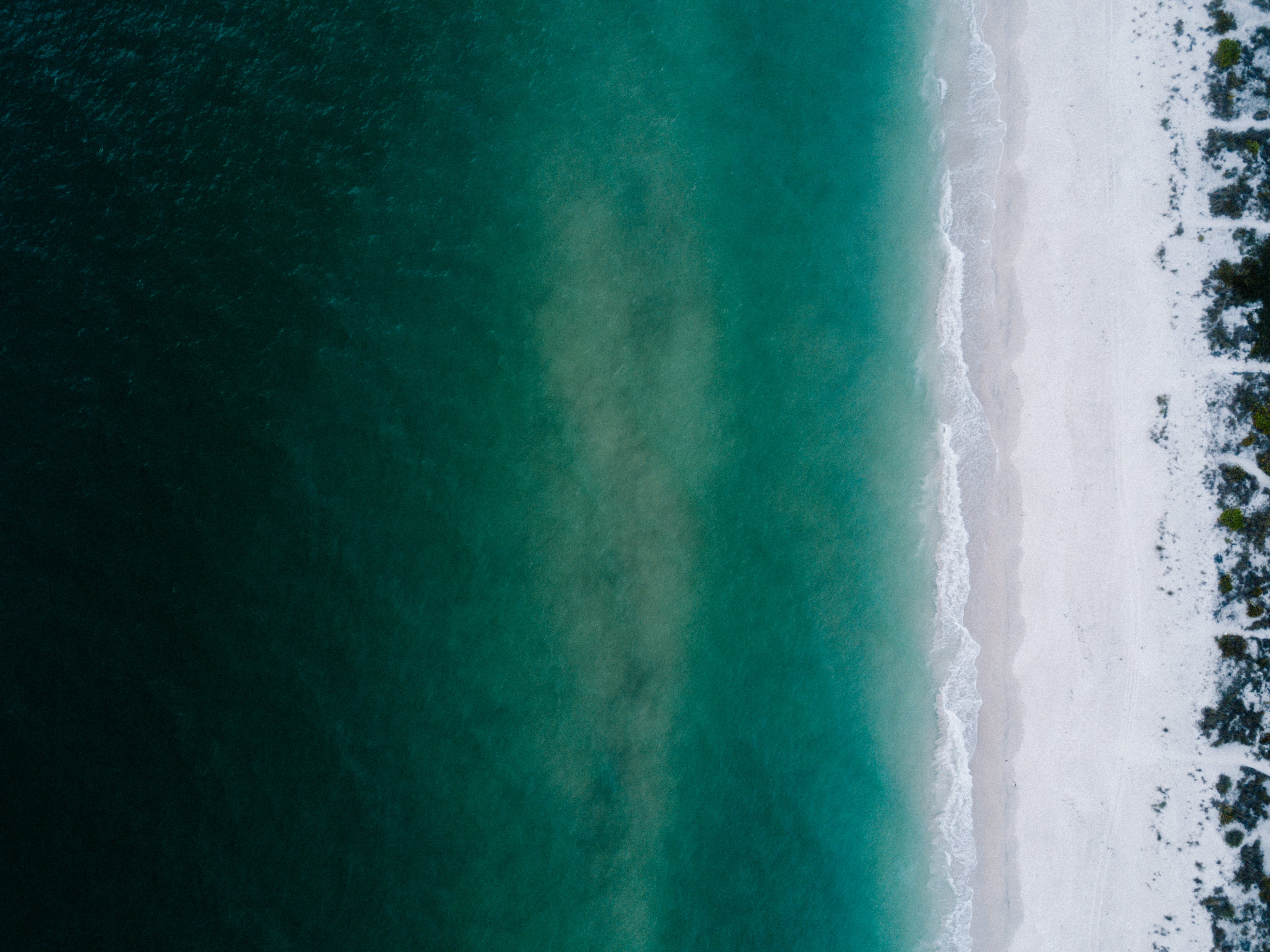 Teal and White Body of Water Wallpaper