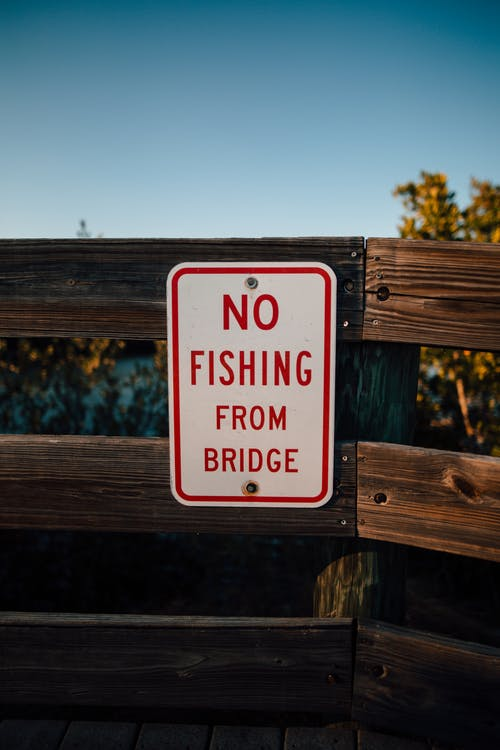 Red And White No Fishing From Bridge Sign