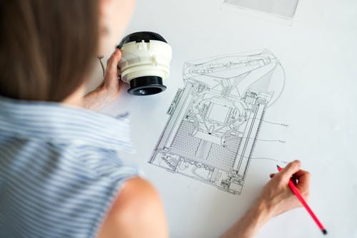 Female Engineer Designing Equipment
