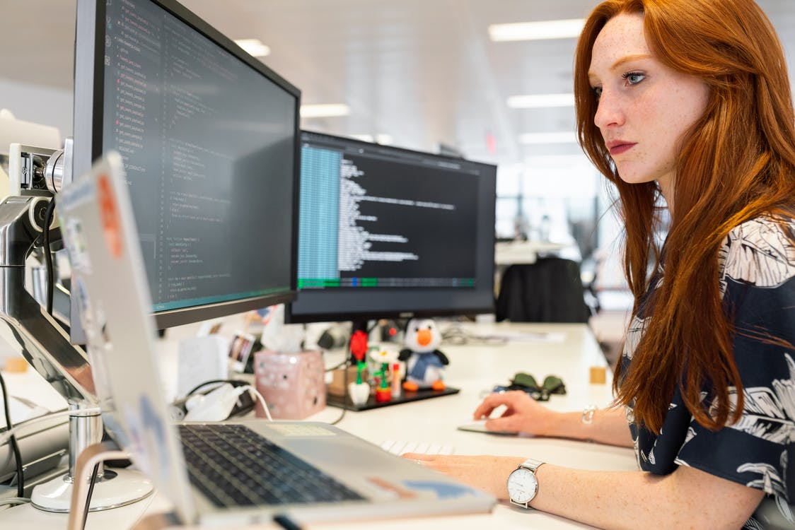 Woman Coding on Computer for virtual assistant providers