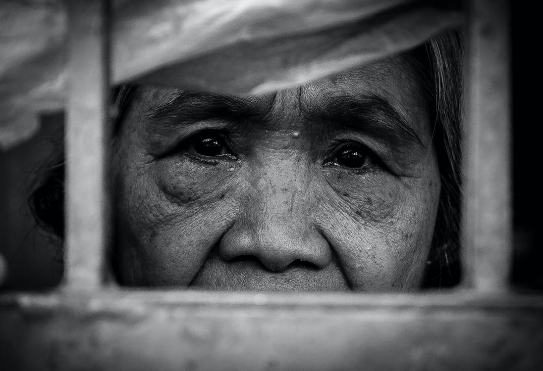 Grayscale Photo of An Elderly Person