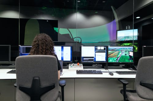 Female Engineer Controlling Flight Simulator