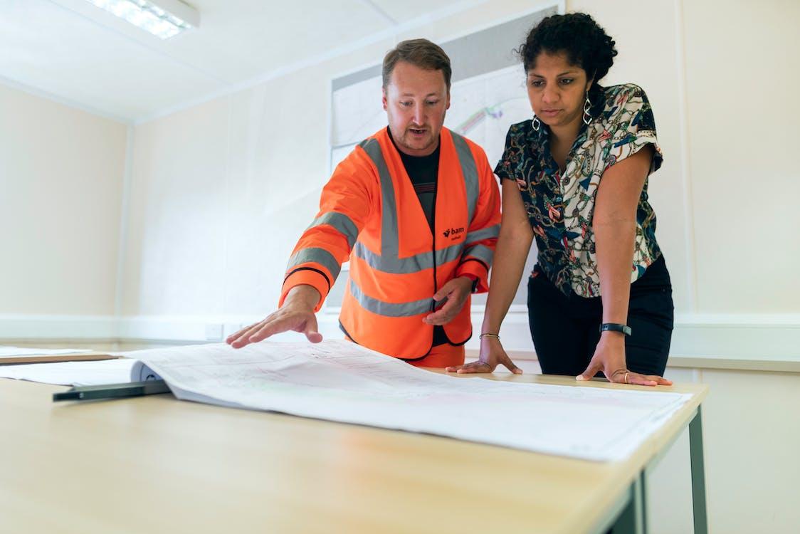 Engineers Looking at Blueprint