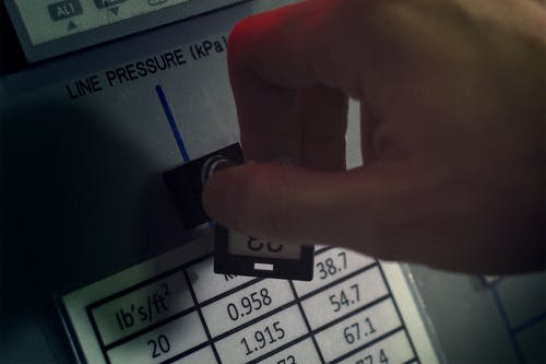 Person Turning Pressure Key