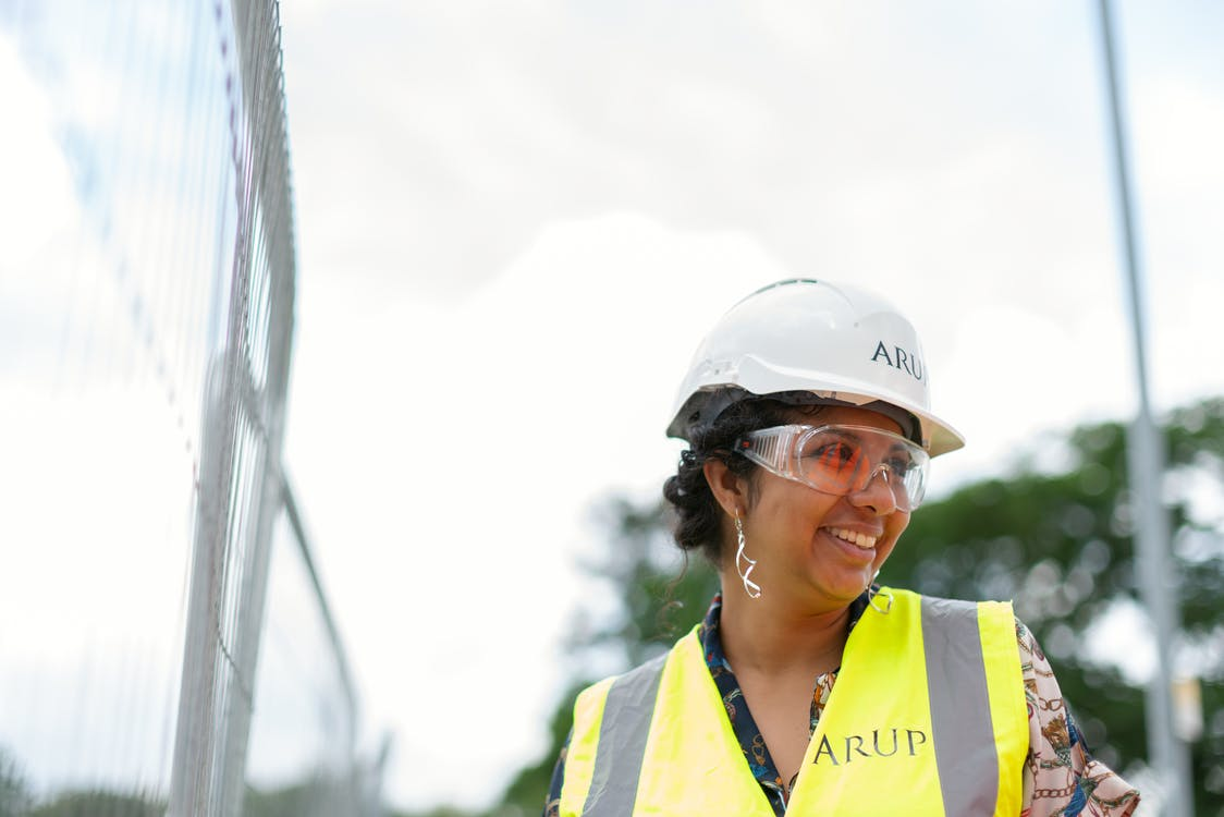 Female Engineer in Hard Hat and Yellow Vest