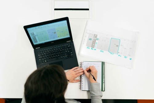 Female Engineer Taking Notes
