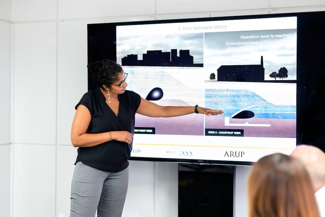 Female Engineer Holding Presentation