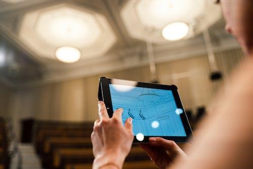 Female Engineer Holding Digital Tablet