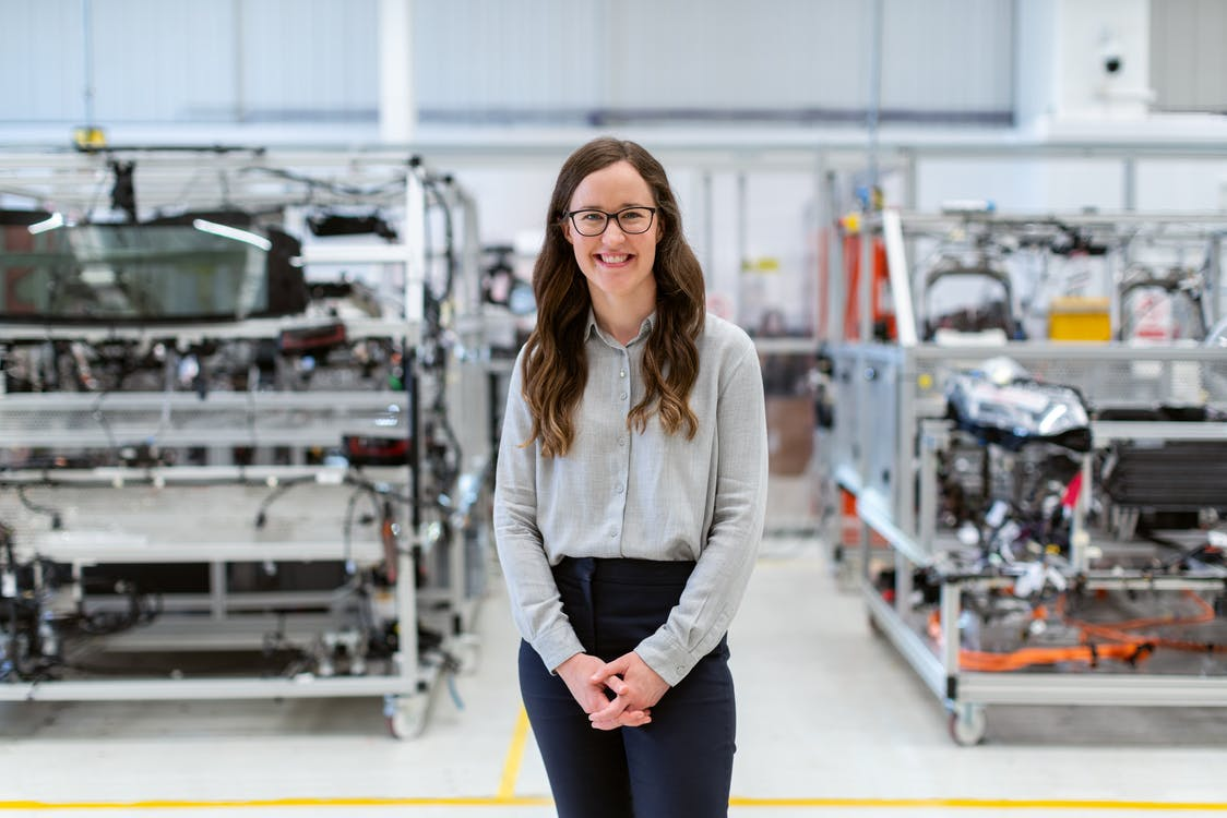 Female Engineer Standing in Workshop