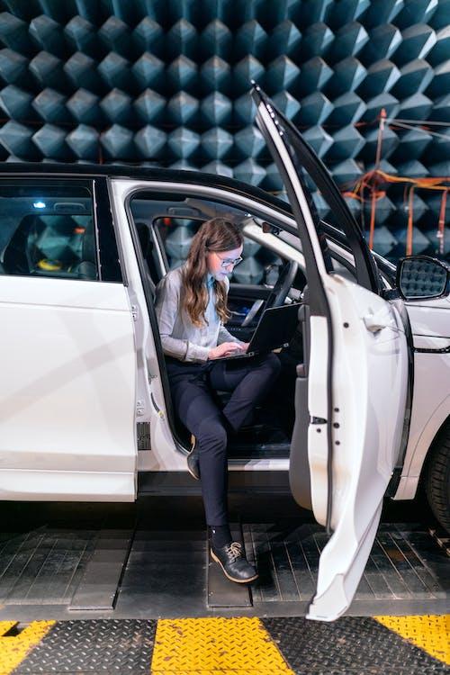Photo Of Female Engineer Sitting Inside A Car