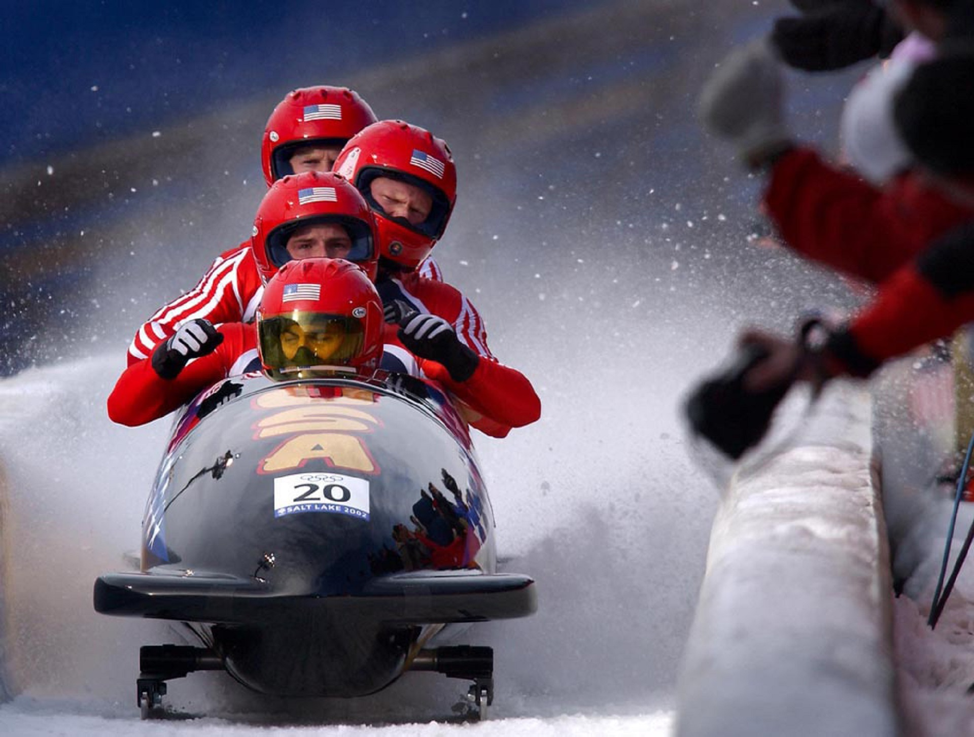 Four Person Riding on Snow Mobile