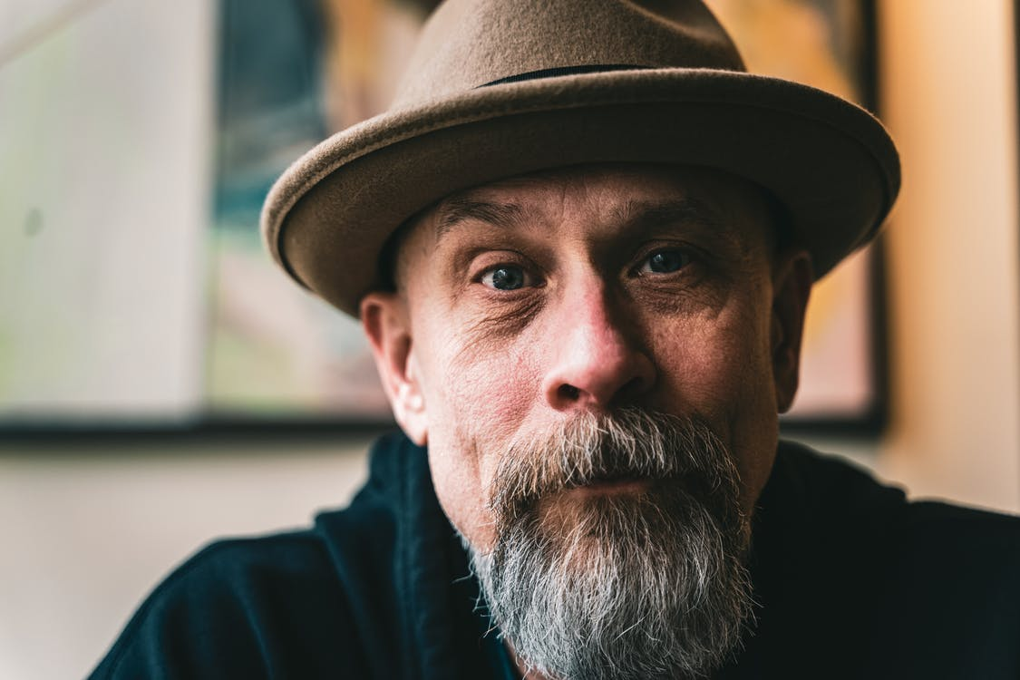 Portrait Of An Old Man Wearing Brown Fedora Hat