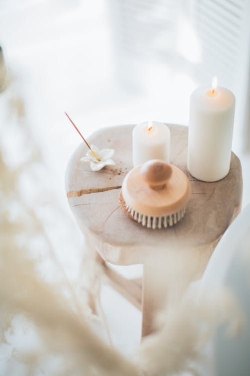 Incense and White Candles on a Stool