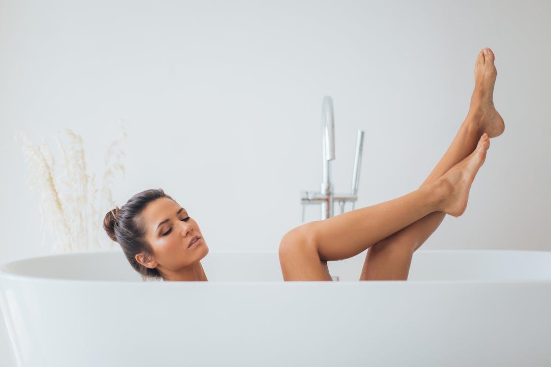 Woman Posing In Bathtub