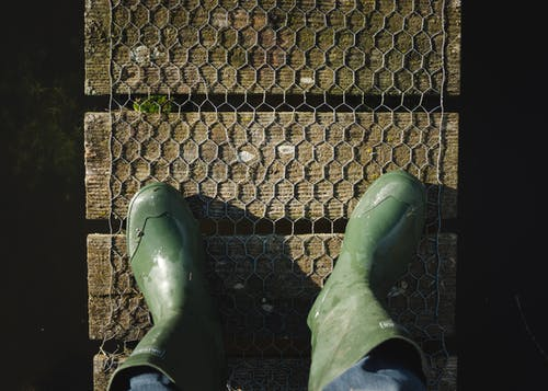 Person Wearing Green Boots