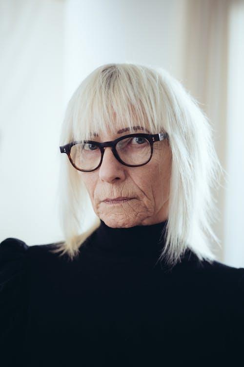 Woman In Black Shirt Wearing Black Framed Eyeglasses